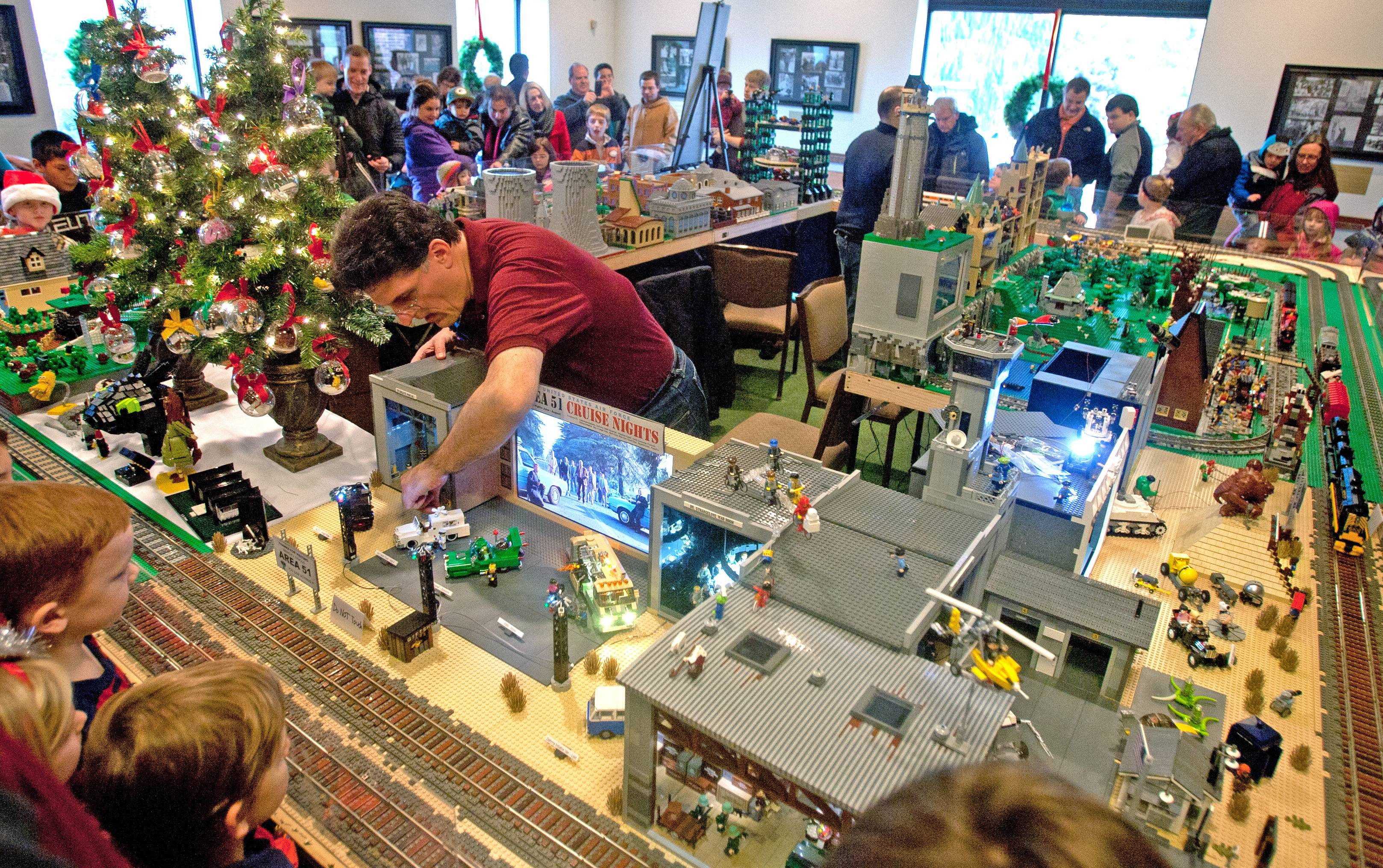Brian Williams, of the Northern Illinois Lego Train Club, monitors a portion of the Christmas show at Cantigny Park in Wheaton.