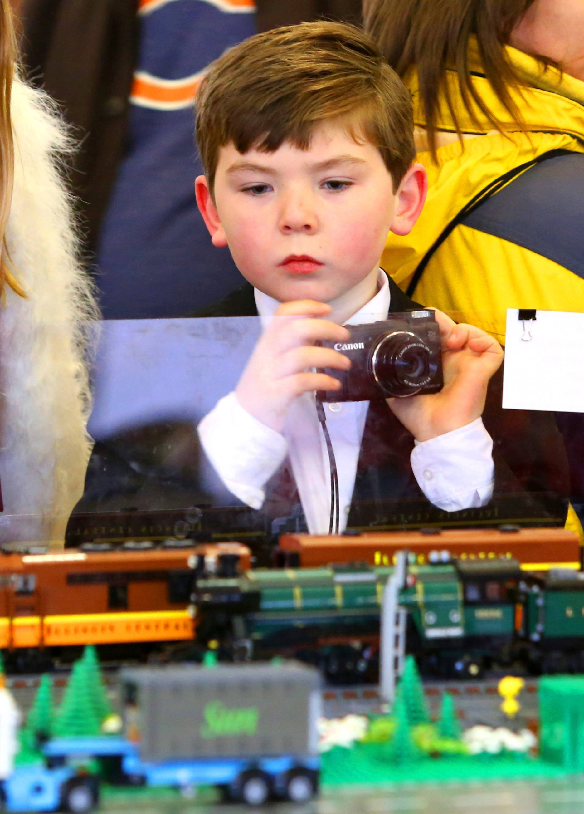 "Michael Schlereth, 9, of Winfield is one of thousands who attended the Northern Illinois Lego Train Club's 13th annual Christmas show at Cantigny Park. ""It's great to see the reaction when the kids come,"" Snow said."
