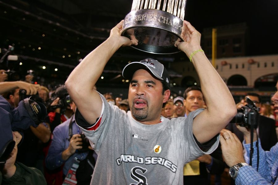White Sox manager Ozzie Guillen celebrated his team's World Series title in 2005. He also shares something in common with all of Chicago's championship coaches of recent vintage: facial hair.