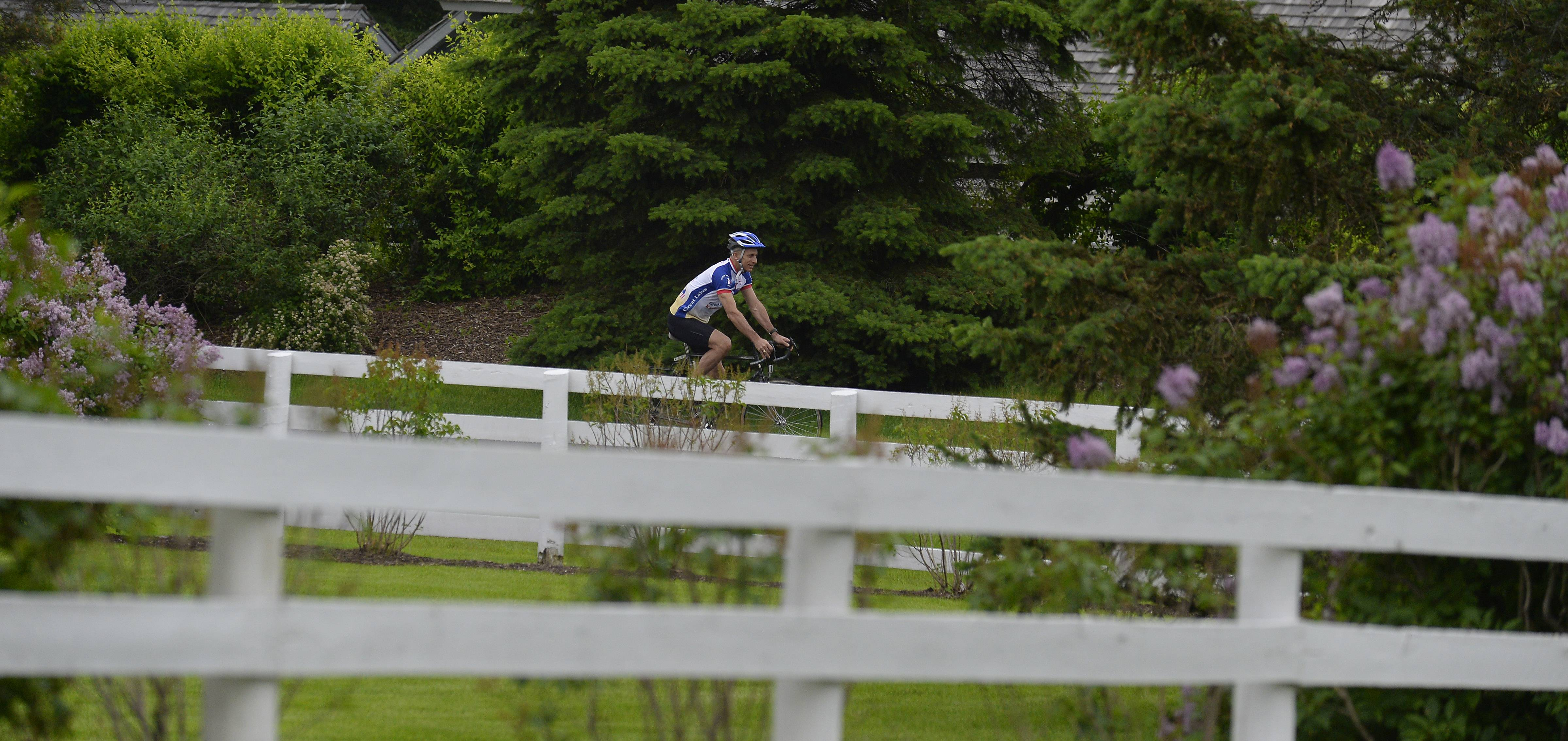 "An avid cyclist who has finished triathlons and Ironman Wisconsin, David Hirsch of Barrington has completed a few 100-mile ""century"" rides. He needs to pile up consecutive centuries this month as he pedals 2,211 miles in 21 days to raise funds and awareness for fatherhood charities."