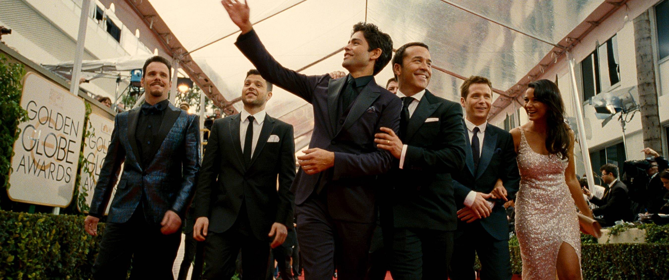 "Vince (Adrian Grenier, center) returns with his posse — Johnny (Kevin Dillon), Turtle (Jerry Ferrara), agent Ari Gold (Jeremy Piven), Eric (Kevin Connolly) and Sloan (Emmanuelle Chriqui) — for the film ""Entourage."""