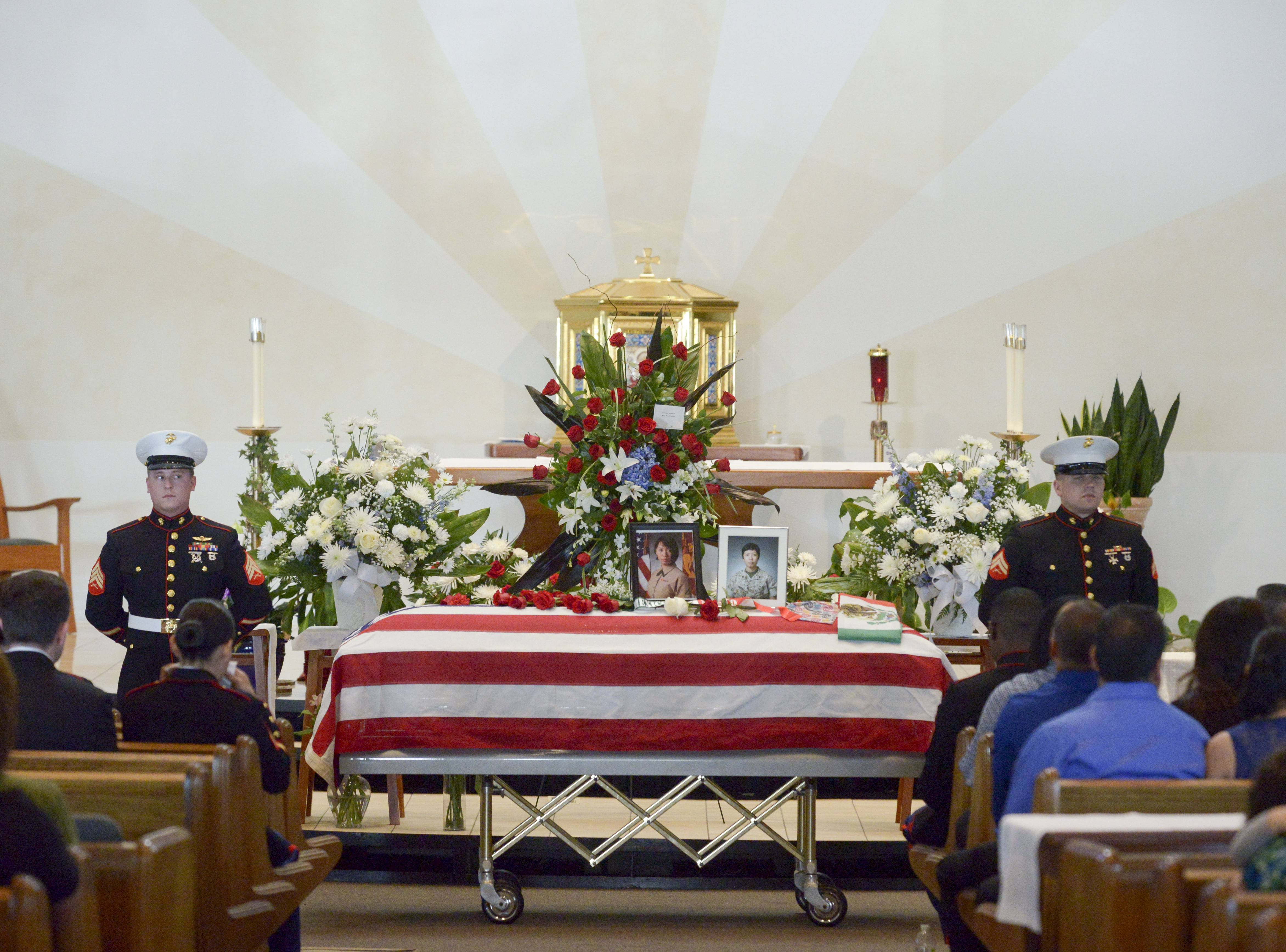A Marine honor guard flanks the casket of Marine Cpl. Sara A. Medina during the funeral service Wednesday for her at St. Mary Immaculate Parish in Plainfield. Medina was killed in a helicopter crash while on a relief mission in Nepal.