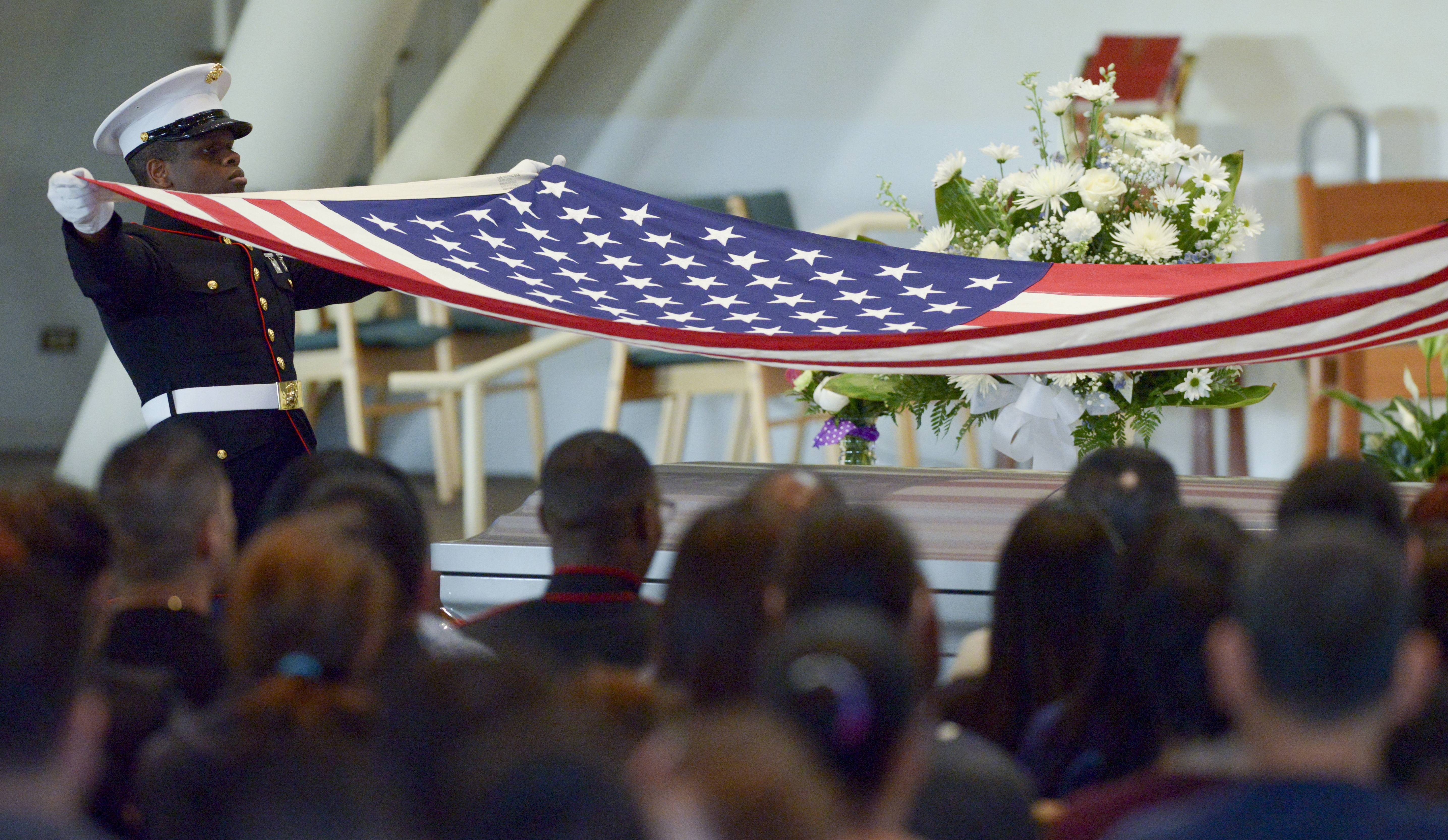 A Marine honor guard prepares to fold the American Flag from the casket of Marine Cpl. Sara A. Medina during the funeral service Wednesday for her at St. Mary Immaculate Parish in Plainfield. Medina was killed in a helicopter crash while on a relief mission in Nepal.