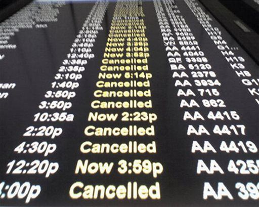 A departure monitor at Chicago's O'Hare International Airport where many flights were canceled and others delayed by a winter storm in 2008.
