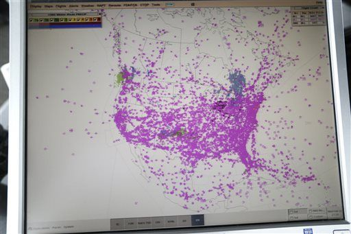 A computer screen shows all air traffic in real time over North America in the control tower at O'Hare International Airport.