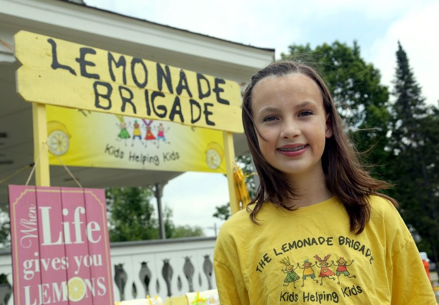 Aubrey Hennig, of McHenry is an organizer of Lemonade Brigade. The children are raising money for 17-year old Savanna Suberla of Lakemoor, who suffers from neurofibromatosis.