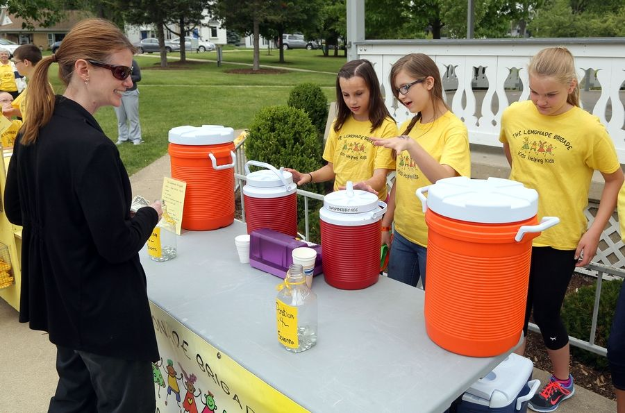Maura Kirchner of McHenry, left, orders lemonade from Aubrey Hennig, left, Samantha Parrish and Morgan LoMonaco on Friday.