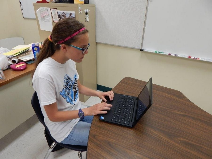 Kelli Tosic, a seventh-grader at Palombi Middle School, works on a Chromebook computer.