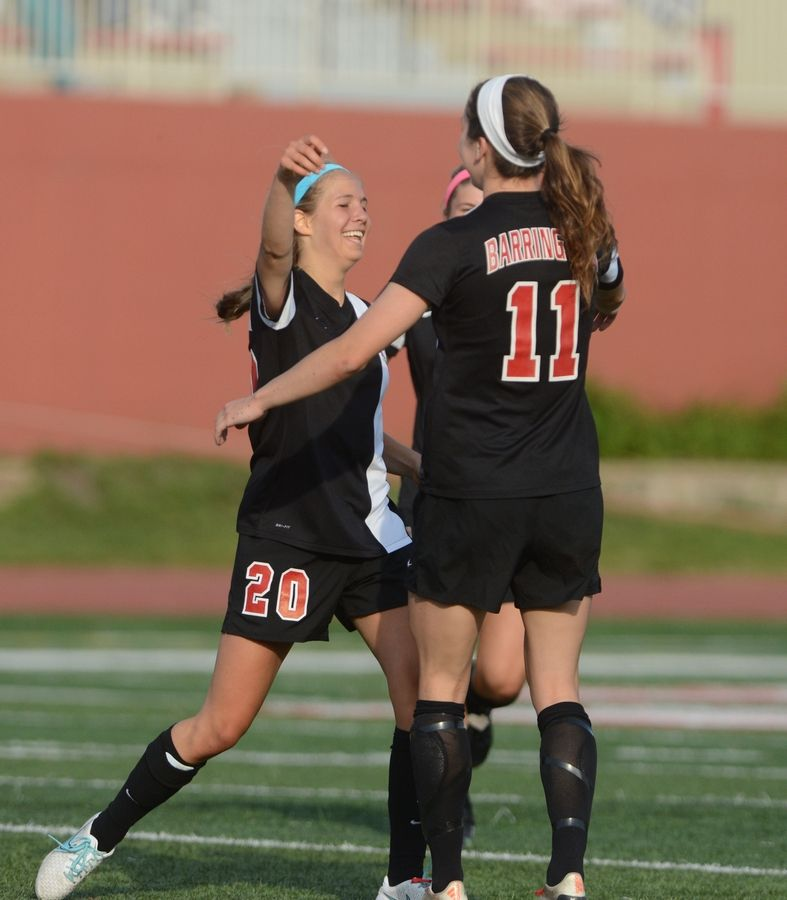 Ann Marie Niro, left, celebrates the winning goal with Jenna Szczesny of Barrington during the second half of the Class 3A third-place game against Collinsville on Saturday.