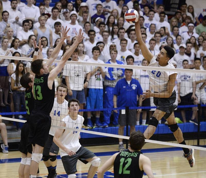 Vernon Hills' Lem Turner rises on the attack against Glenbard West's Will  Church during the
