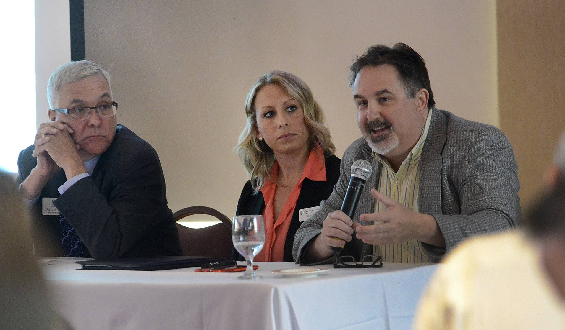"Mental health advocates, from left, Gregg Stockey, Kristin Vana and Bob Zima address the Schaumburg Business Association Tuesday on the topic ""Behavioral Health Care in a Challenging Funding Environment."""