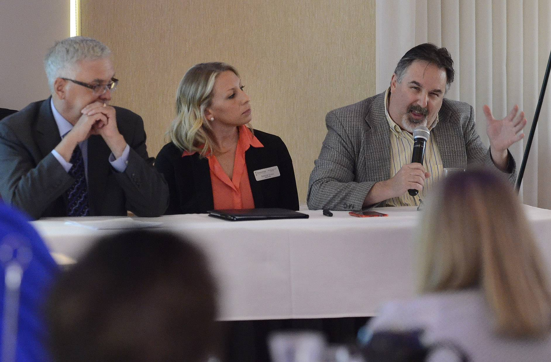 Mental health advocates, from left, Gregg Stockey, Kristin Vana and Bob Zima addressed the Schaumburg Business Association Tuesday on the challenges of their field in today's difficult funding environment, as well as how the Affordable Care Act is offering more opportunities for mental health treatment.