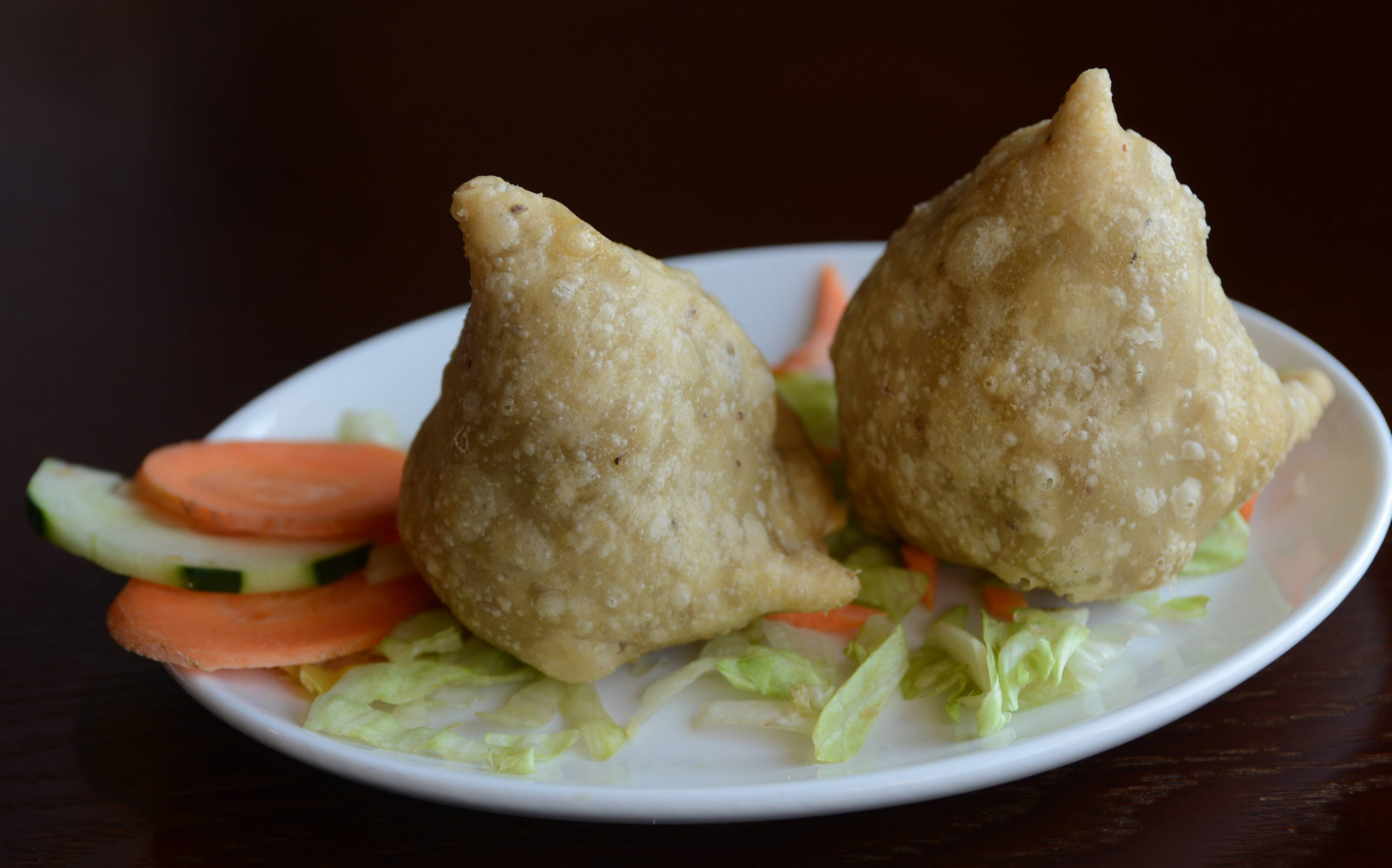Keema samosa, flaky dumplings stuffed with minced lamb, are a perfect starter at Rolling Meadows' Spice Grill.