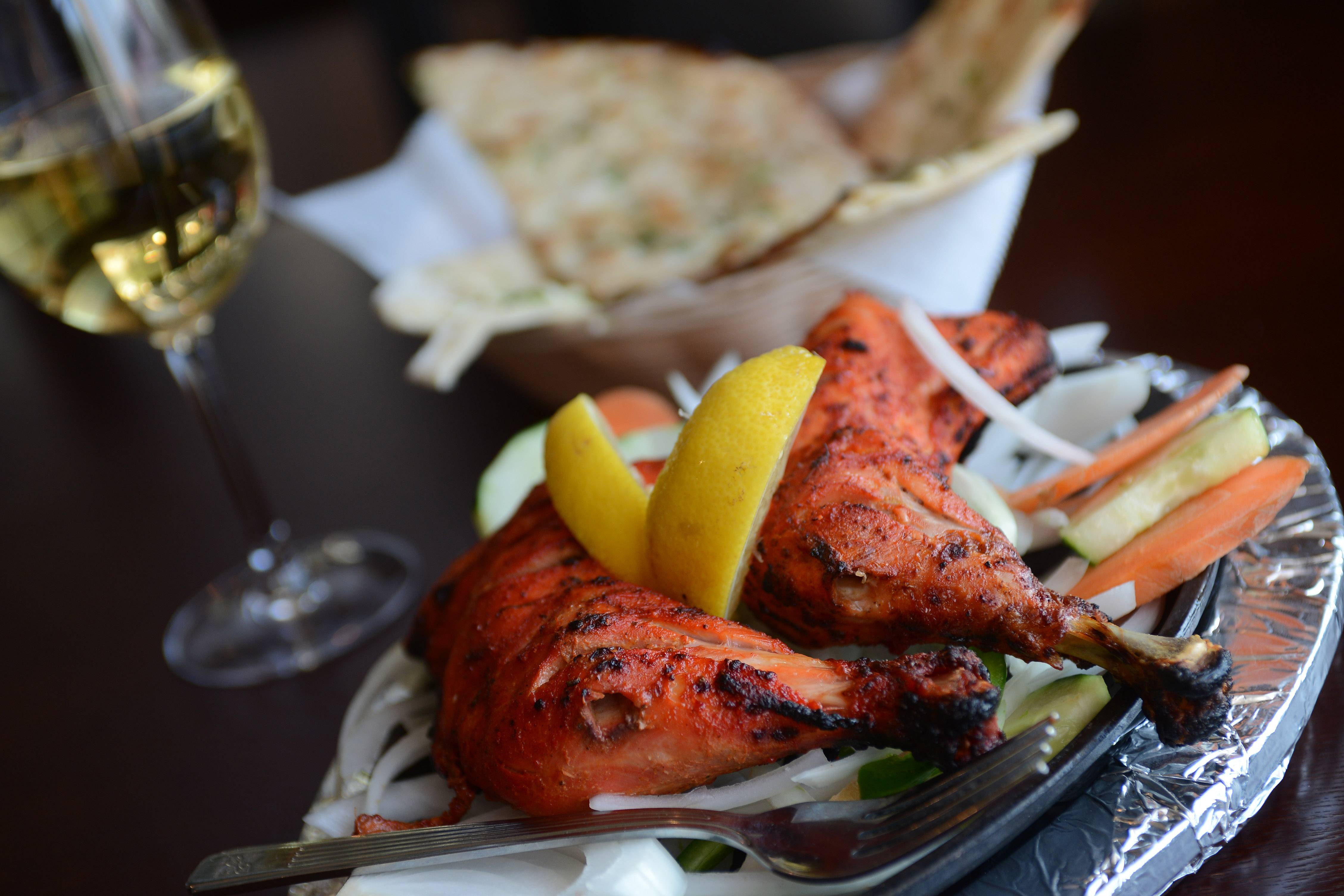 Tandoori chicken is cooked in a traditional tandoor, or clay oven, at Spice Grill in Rolling Meadows.