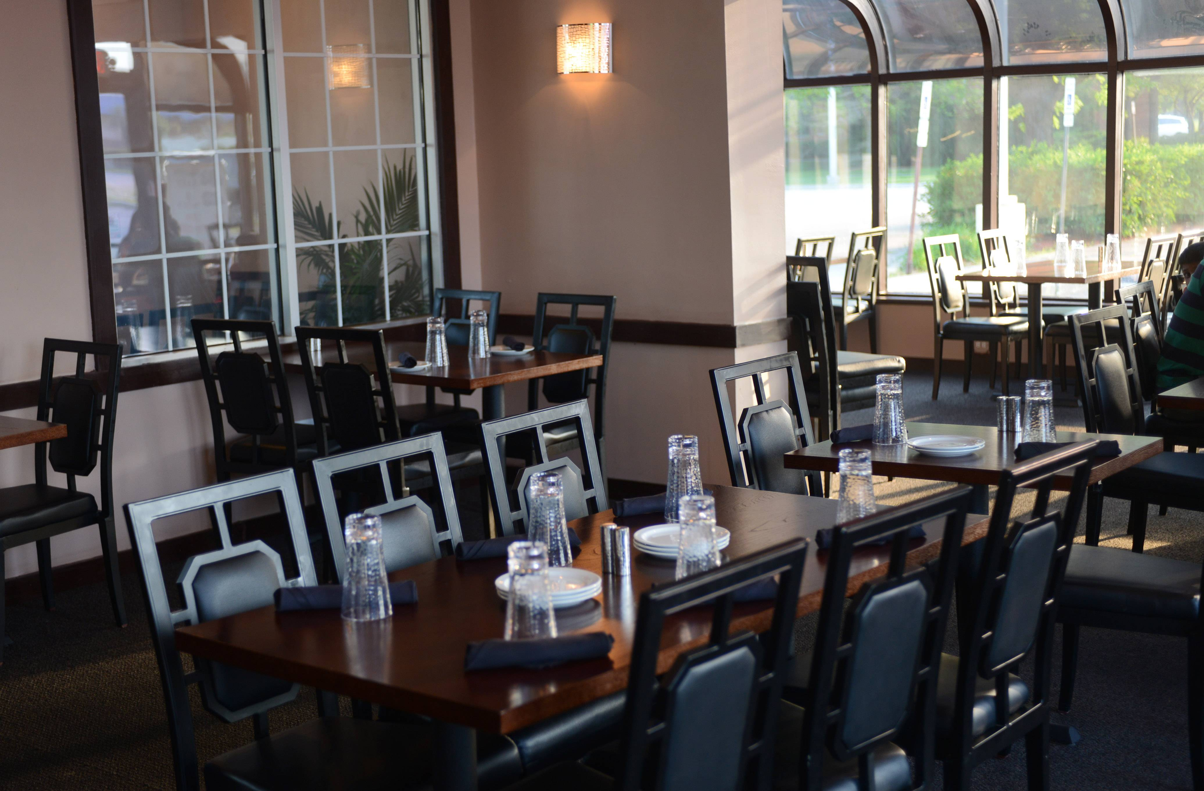Dining space at Spice Grill in Rolling Meadows has an intimate feel, despite being roomy, with modern decor and low lighting.