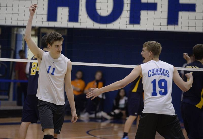Vernon Hills' Dylan DeBoer, left, celebrates a kill during the Cougars'  state