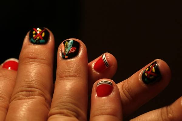 Nail Artist Paints Blackhawks Designs For Customers