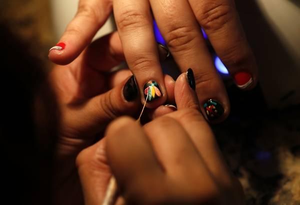 Nail Artist Paints Blackhawks Designs For Customers