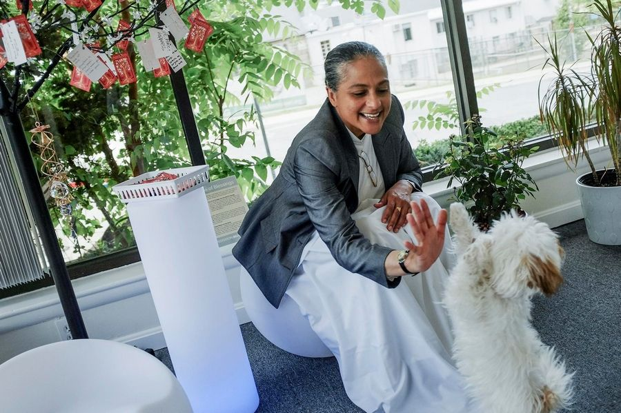 Sister Jenna Mahraj plays with a dog at the at the Meditation Museum in Silver Spring, Md. Promoting the religious component of meditation is part of the purpose of the center, which is more about spiritual advocacy than a museum in the classic sense.