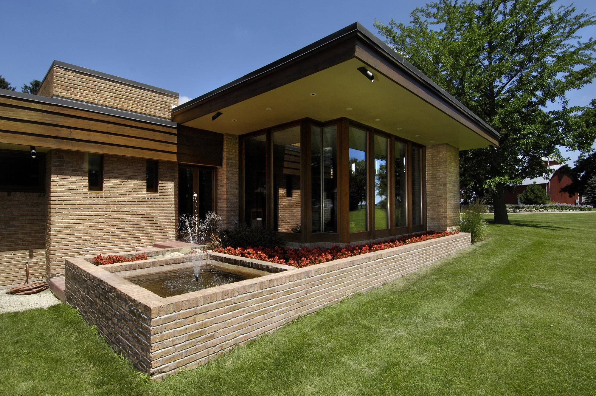 A fountain sprinkles outside the large living room windows of the Muirhead Farmhouse, which was designed by Frank Lloyd Wright in 1951. Its owners hope to have the home added to the National Register of Historic Places.