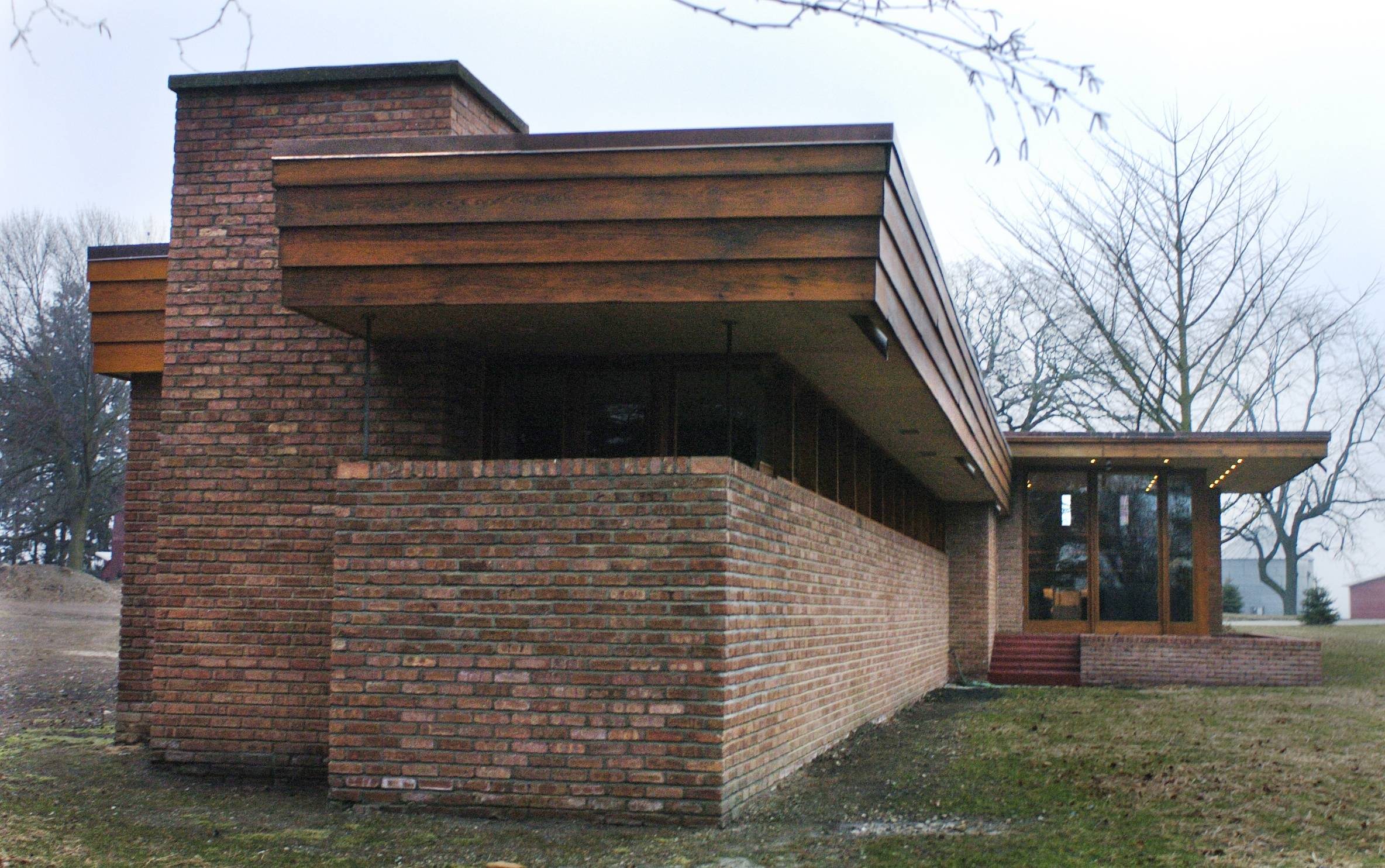 The Muirhead farmhouse has a Usonian design, a term coined by Frank Lloyd Wright to describe buildings uniquely suited for middle-income citizens of the United States or North America. Wright believed such buildings were the most challenging to design. The property, located near Plato Center, may be the only farmhouse Wright designed.