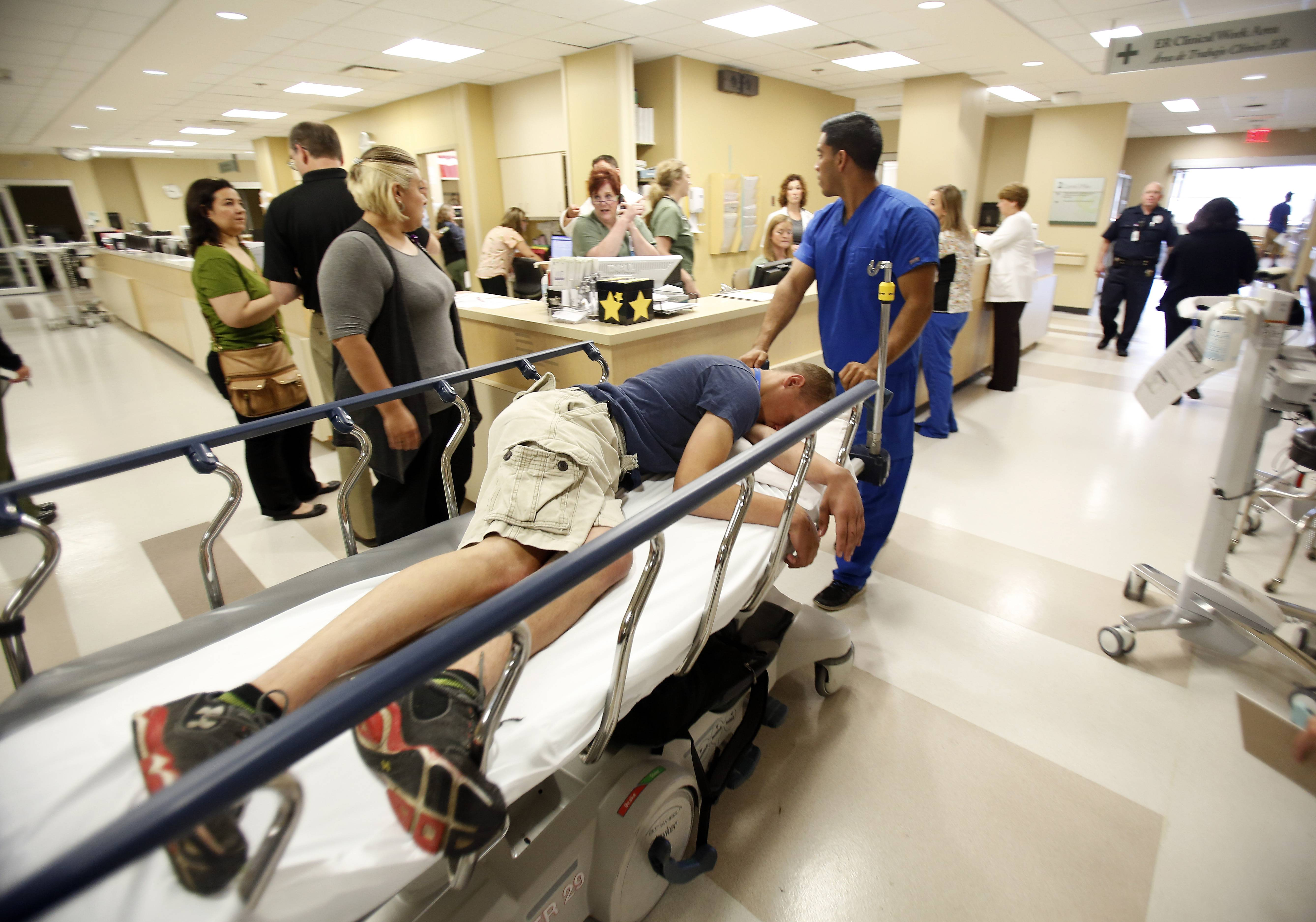 Role-player Cameron Skaja, 17, of Elgin is rolled into the emergency room Tuesday at Advocate Sherman Hospital in Elgin as part of a school shooting training drill conducted by the Elgin police and fire departments.