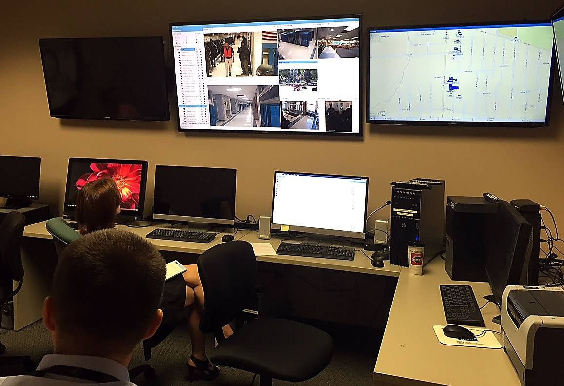 Elgin police watch a live feed of a shooting training drill Tuesday at Kimball Middle School.
