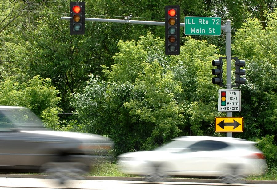 East Dundee's village board voted Monday to renew the contract with RedSpeed Illinois, a company that operates the two red-light cameras in the village.