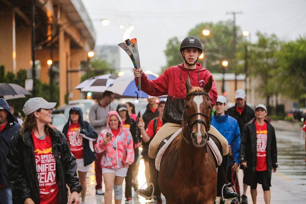 Jake McManus of Lake Barrington carried the Special Olympics torch aboard his beloved horse, Harry, on Saturday through the streets of downtown Chicago. Jake is the youngest member of the Special Olympics U.S. equestrian team that will compete at the World Games next month.