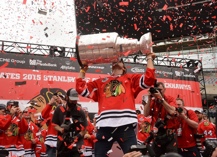 Bob Chwedyk/bchwedyk@dailyherald.comNiklas Hjalmarsson kisses the Cup at the Hawks Rally at Soldier Field.