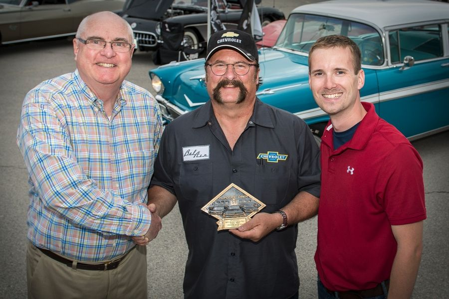 The Classic Gem Award, presented by Stratford Square Mall General Manager Doug Kiehn, left, went to Brian Elliot and his 1956 Chevrolet Bel Air. The Roselle resident has owned the car since he was 18.