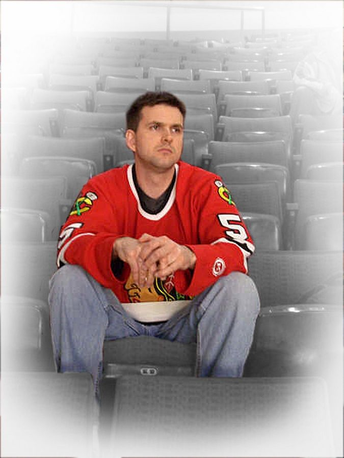 Photo 2 caption: Jay Parsons of Chicago sits amidst a sea of empty seats in the 300 level of the United Center during the Blackhawks game against the L.A. Kings on March 23.