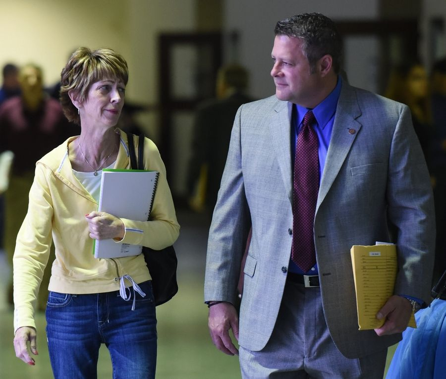 Bonnie Liltz, who is accused of murdering her disabled daughter, walks with her attorney, Tom Glasgow, following a hearing at the Rolling Meadows courthouse Thursday.