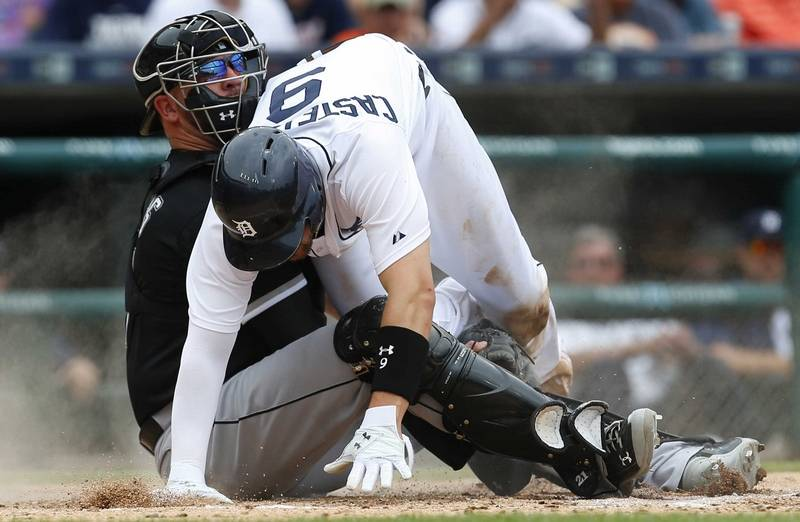Images chicago white sox over detroit tigers 8 7 detroit tigers nick castellanos right is tagged out at home by chicago white mightylinksfo Choice Image