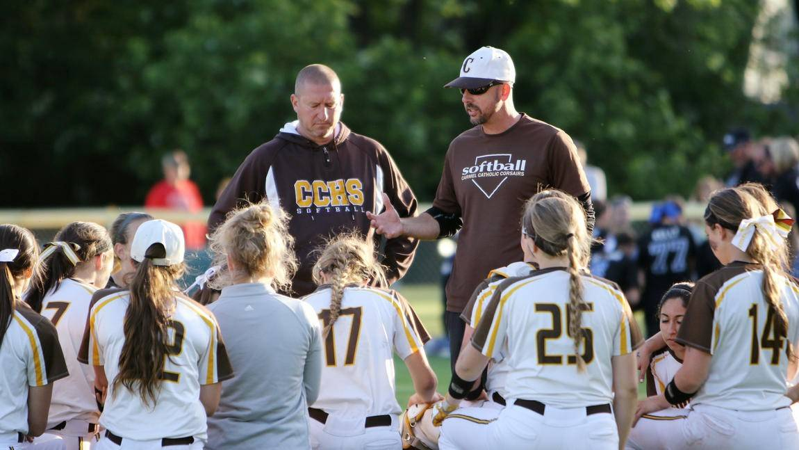 Jason Raymond, right, coached Carmel Catholic's softball team to 30 wins this season. He has been named head girls basketball coach at St. Viator, his alma mater.