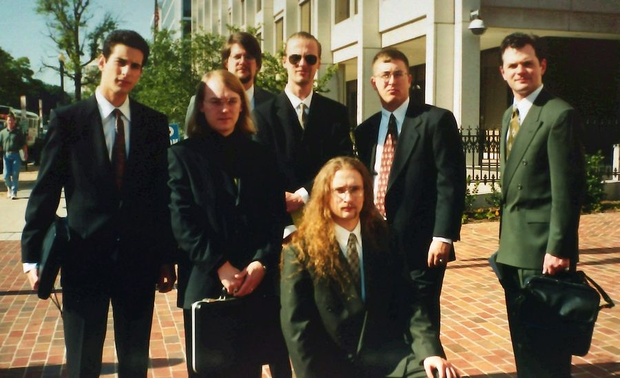 Members of the hacker group L0pht went to Washington for their Senate testimony in May 1998. The hackers outside their hotel on the morning of their testimony were, from left, Kingpin, Brian Oblivion, Weld Pond, Tan, Mudge (kneeling), Space Rogue and Stefan von Neumann.