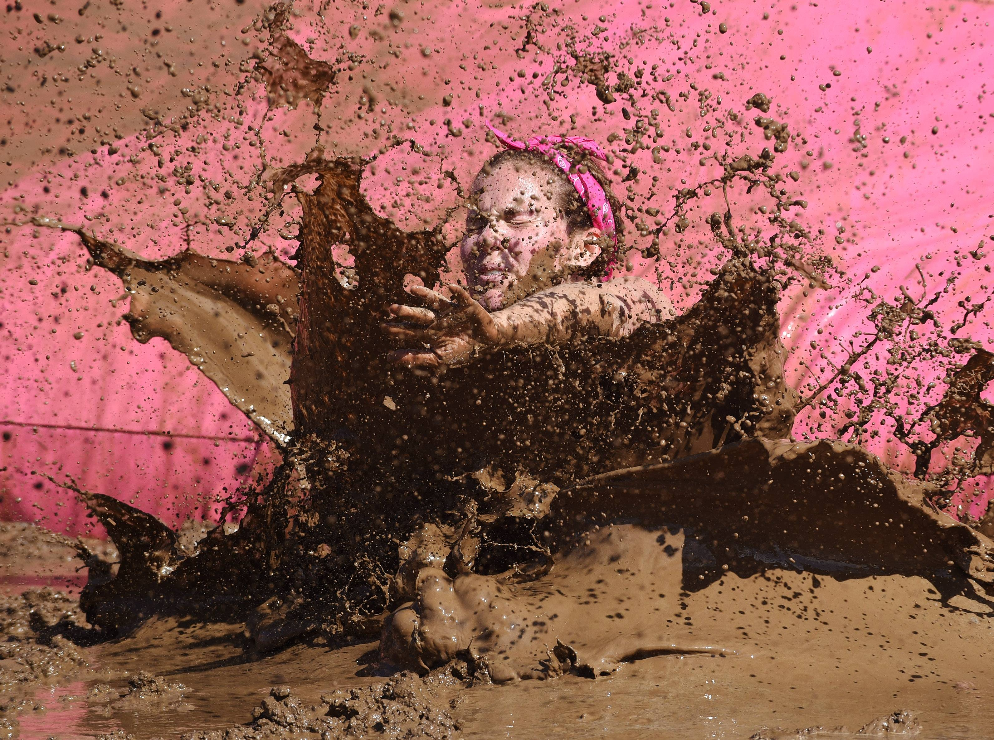 Danielle McKenna of Volo splashes down during the Dirty Girl Mud Run at the Sears Centre in Hoffman Estates Saturday.