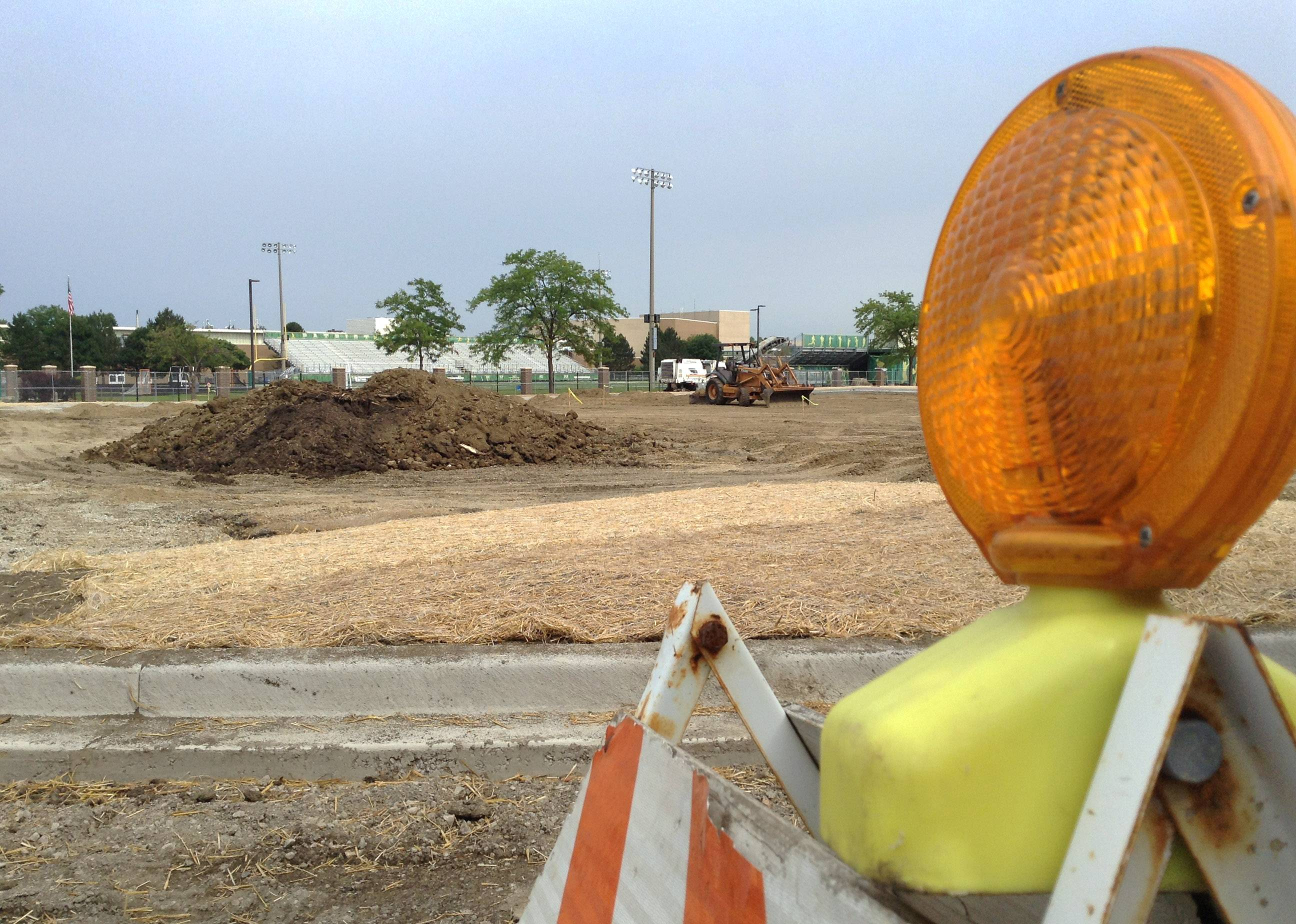 A parking lot at Stevenson High School is being rebuilt with a new lane configuration to separate buses from cars.