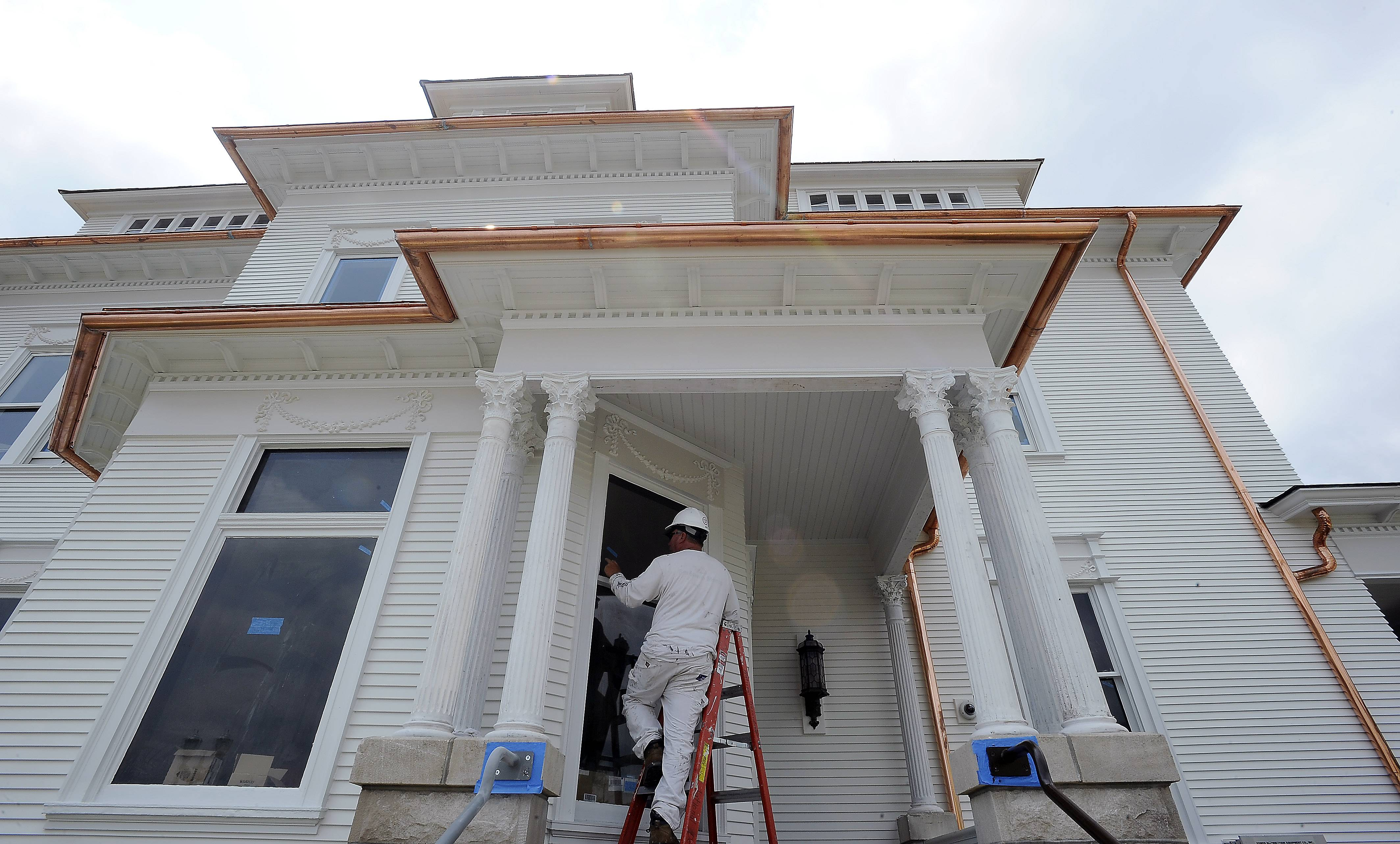 ComCopper Gutters And Downspouts Accent The White House In