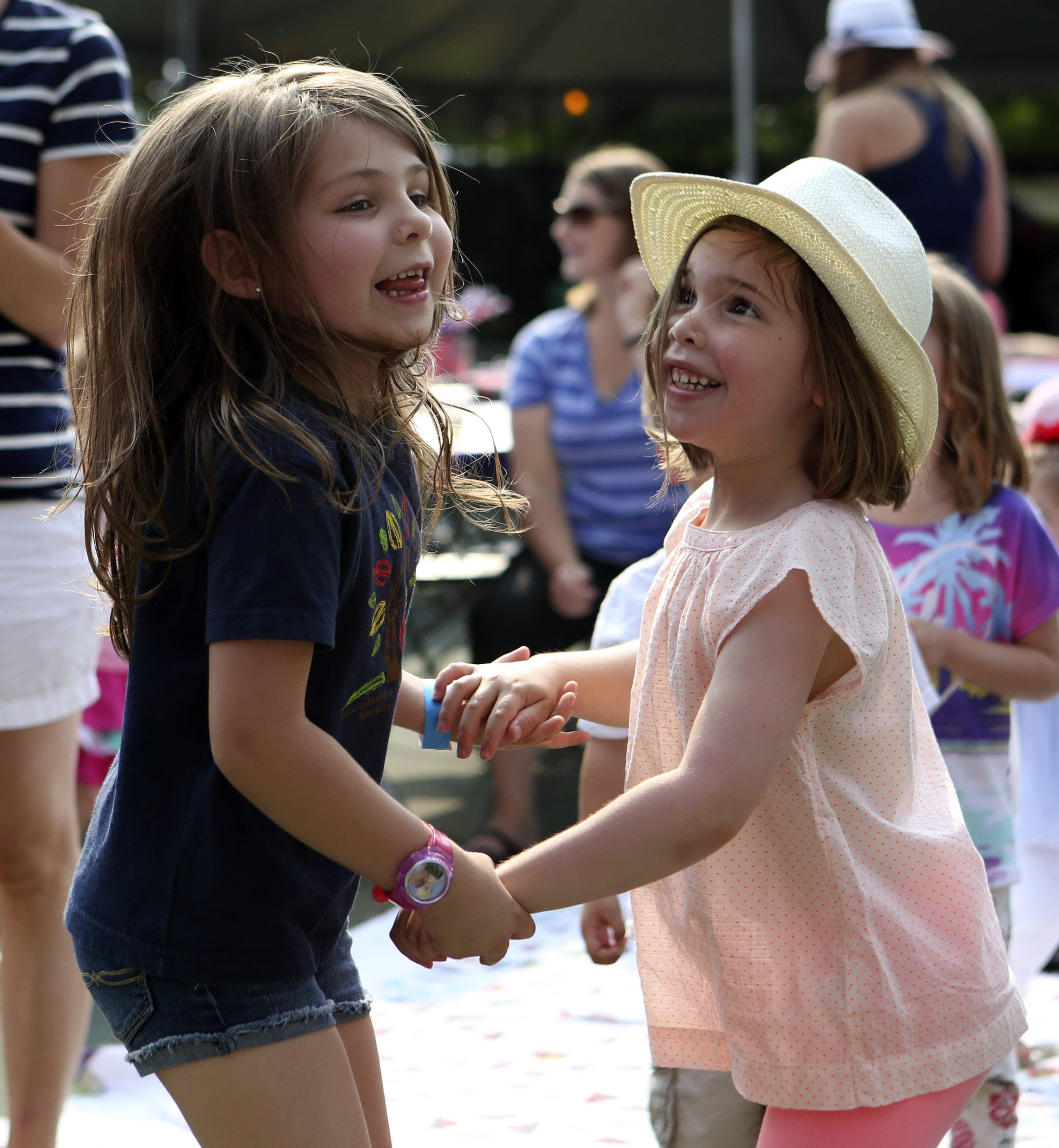 Isabella Bacci, 5, of Long Grove, and Olivia Santosuosso,5, of Lincolnshire, dance during the first day of Lincolnshire's Red, White & Boom celebration on Friday, July 3, at Spring Lake Park in Lincolnshire. The celebration featured a kid's concert, inflatable attractions and a classic car show.