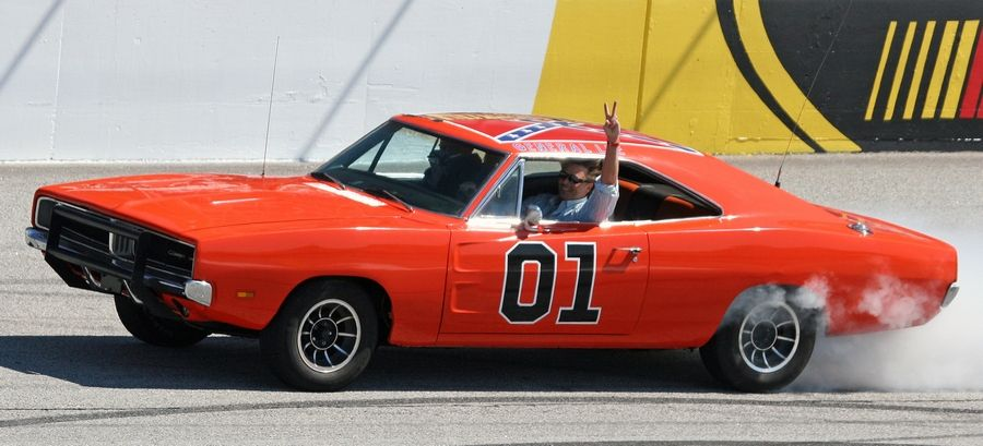 "Actor John Schnieder, star of the 1980s television show ""The Dukes of Hazzard,"" waves from the General Lee before the Kobalt Tools 500 auto race at Atlanta Motor Speedway in Hampton, Ga. Golfer Bubba Watson says he's painting over the Confederate flag on the car he bought from ""The Dukes of Hazzard"" television series. Watson said he'll replace it with the U.S. flag on the roof of the ""General Lee 01."""