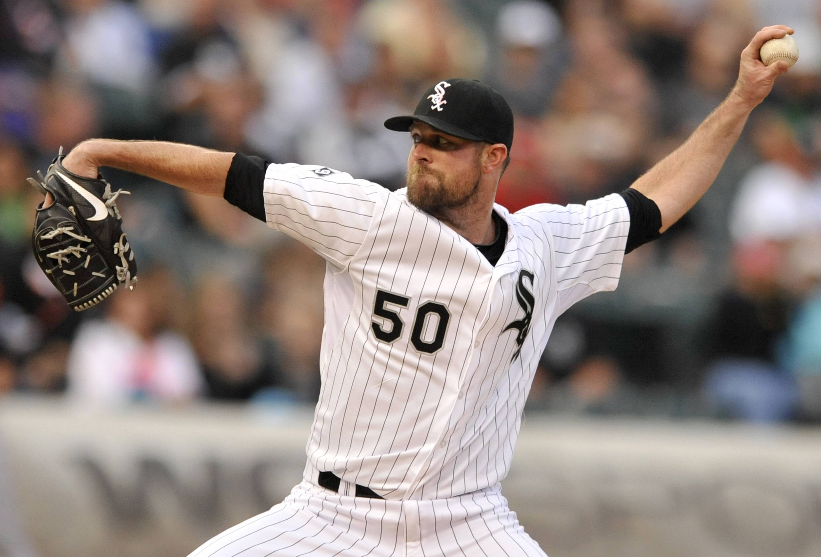 Chicago White Sox starter John Danks delivers a pitch during the first inning of a baseball game against the Baltimore Orioles on Friday, July 3, 2015, in Chicago.