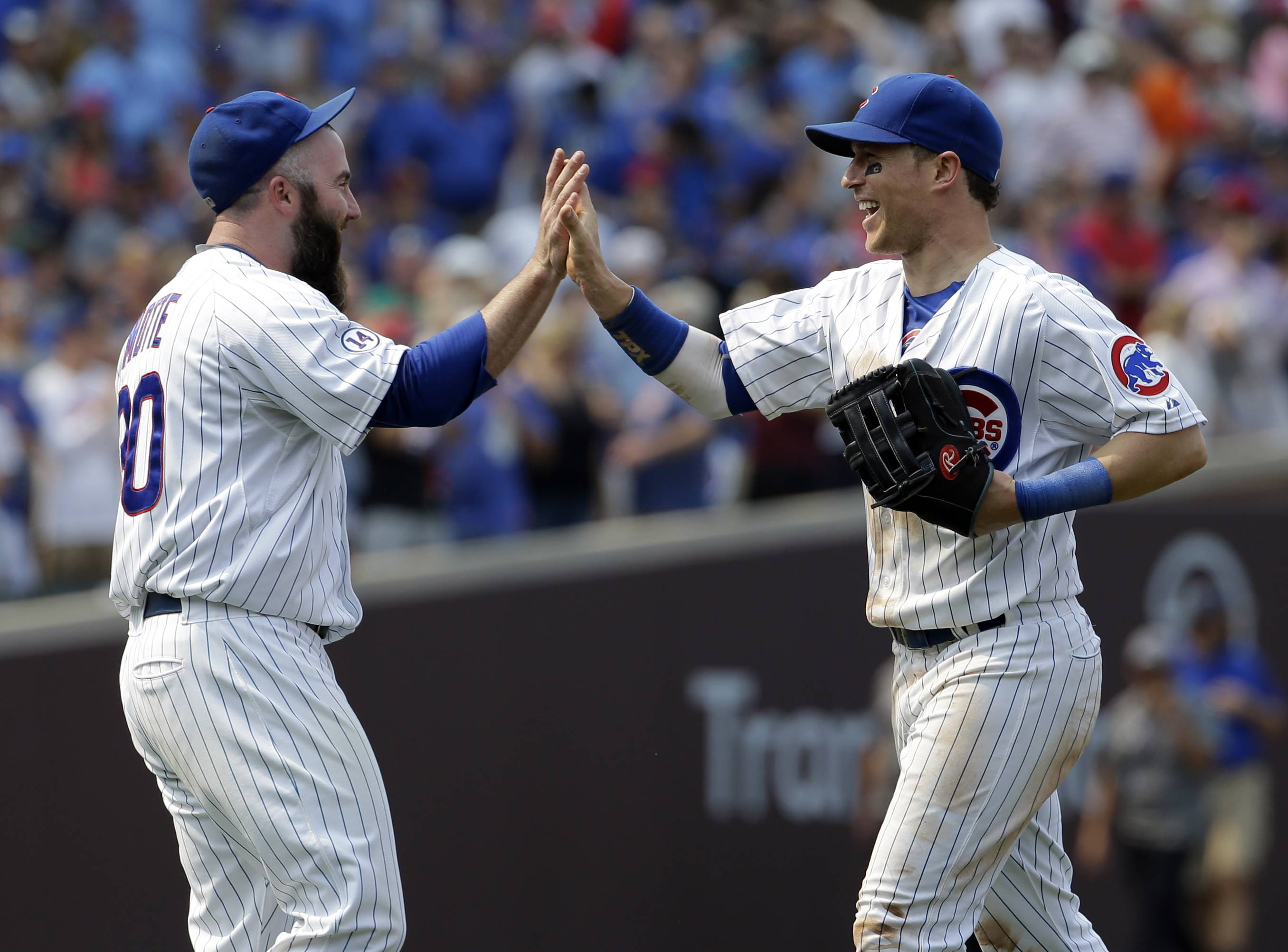 The Chicago Cubs' Chris Coghlan, right, celebrates with relief pitcher Jason Motte after the Chicago Cubs defeated the Miami Marlins 2-0 in a baseball game Sunday, July 5, 2015, in Chicago. The Cubs won 2-0.