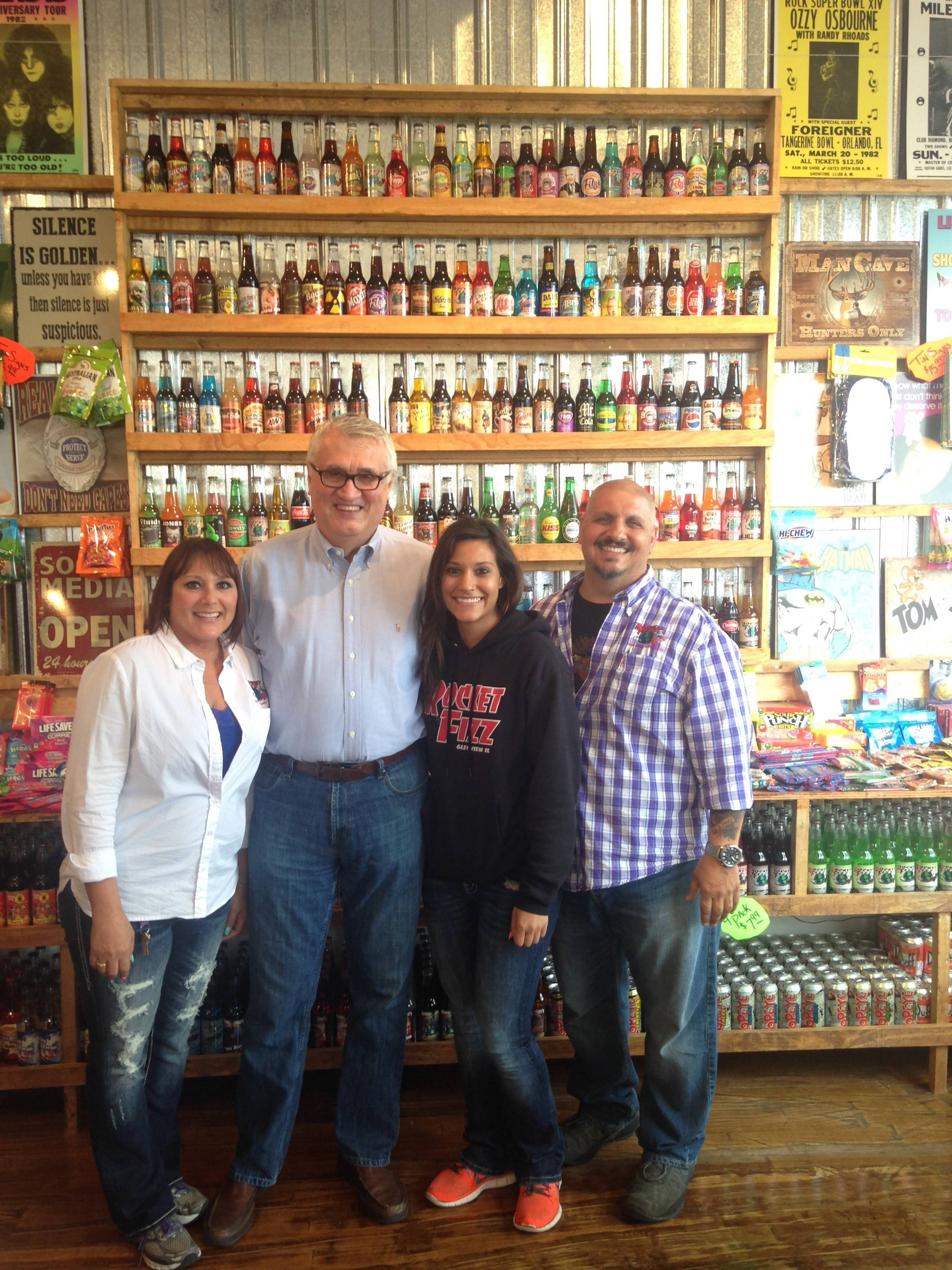 Tonya Brescia, from left, Mayor Ray Rogina, Manager Deana Brescia, and owner Robert Brescia at the new Rocket Fizz Soda Pop and Candy Shop in St. Charles.