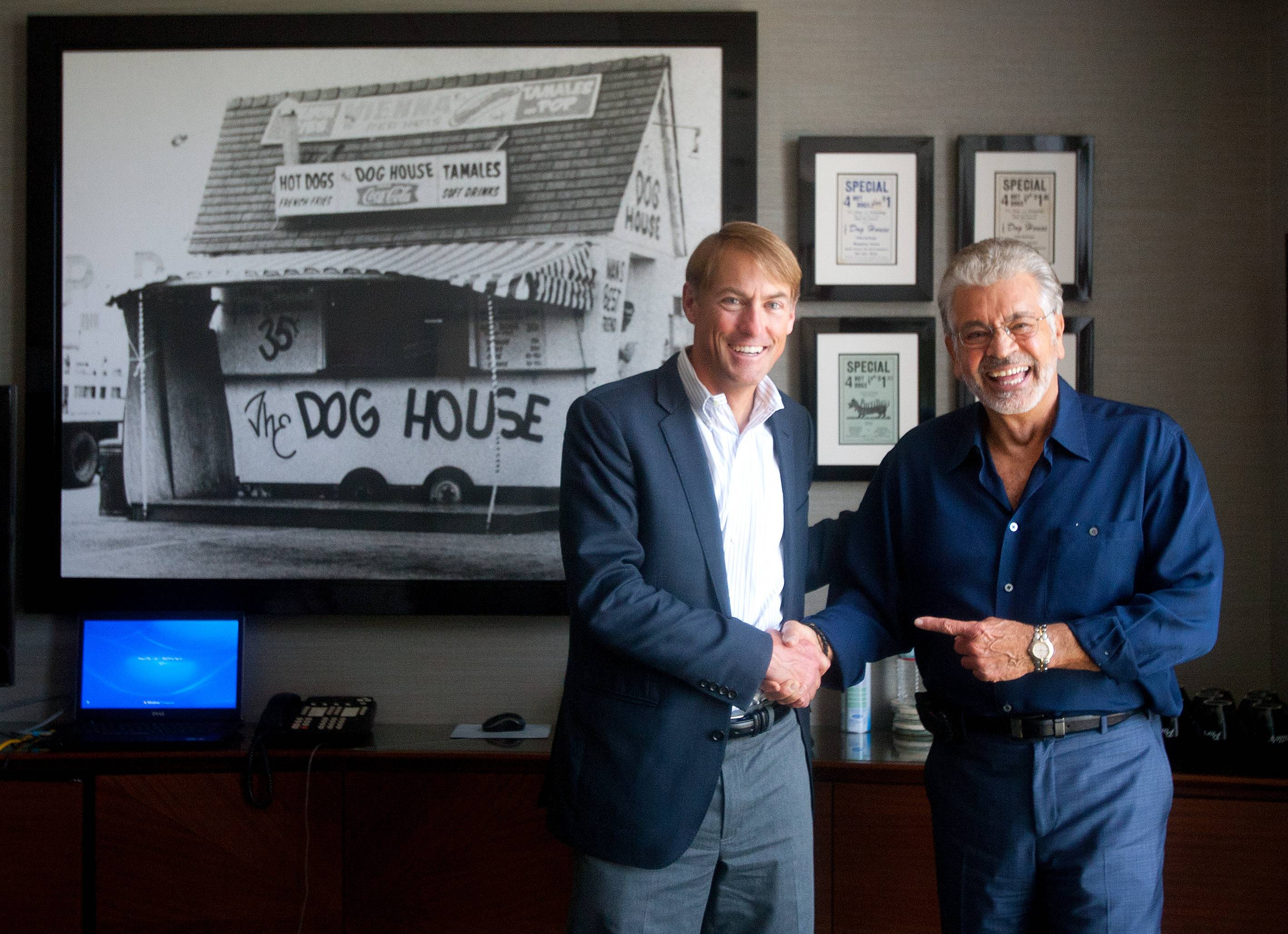 Mike Miles, left, of Berkshire Partners, a private equity firm in Boston, was chosen by Dick Portillo, right, to purchase and run the namesake company Portillo started with a small Villa Park hot dog stand.
