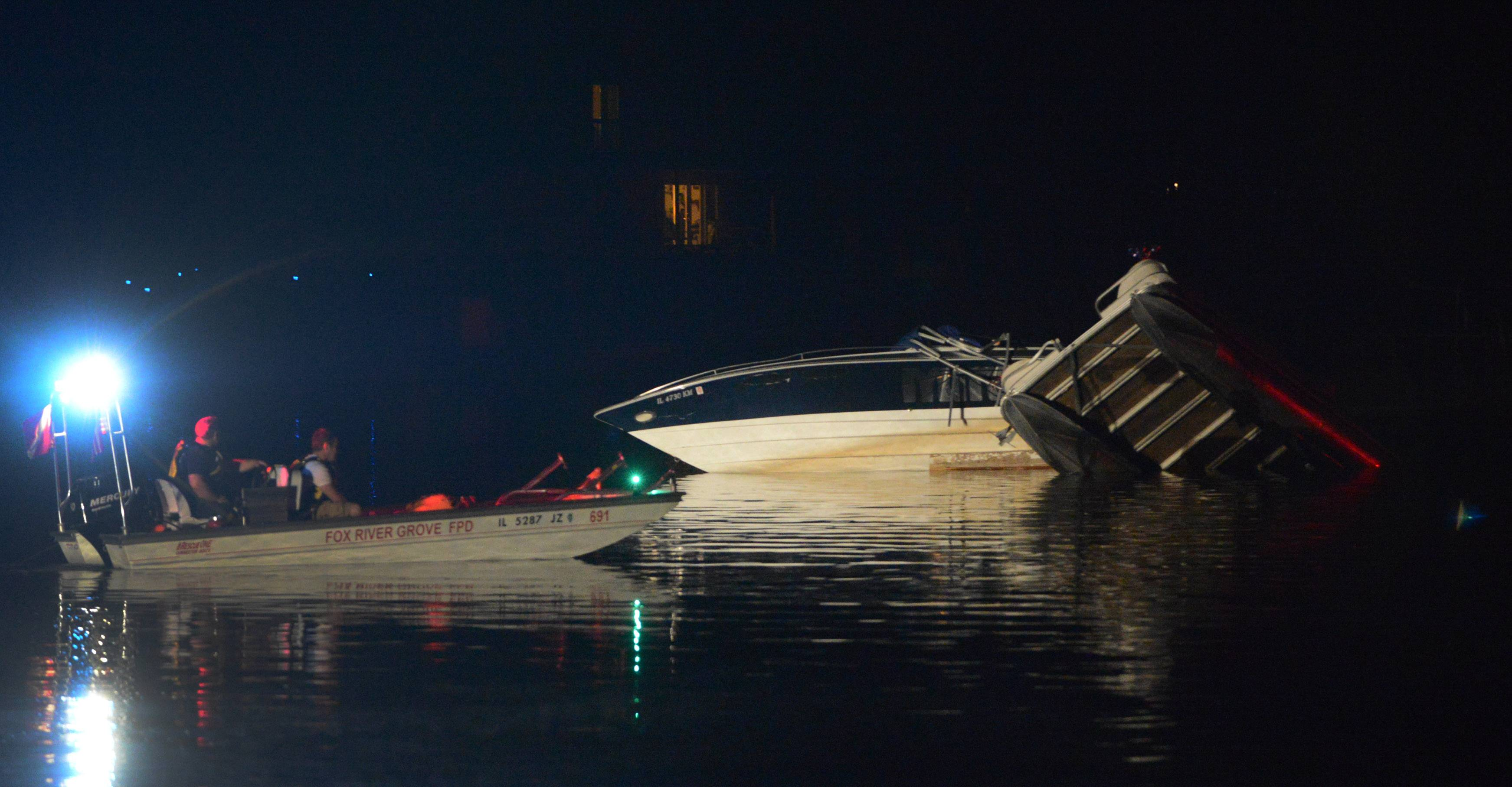 A pontoon boat sits partly submerged in the Fox River after a collision Saturday night involving a speed boat just off Barrington Harbor in Lake Barrington. Illinois Department of Natural Resources police said Monday that alcohol played a role in the crash, which sent four people to the hospital.