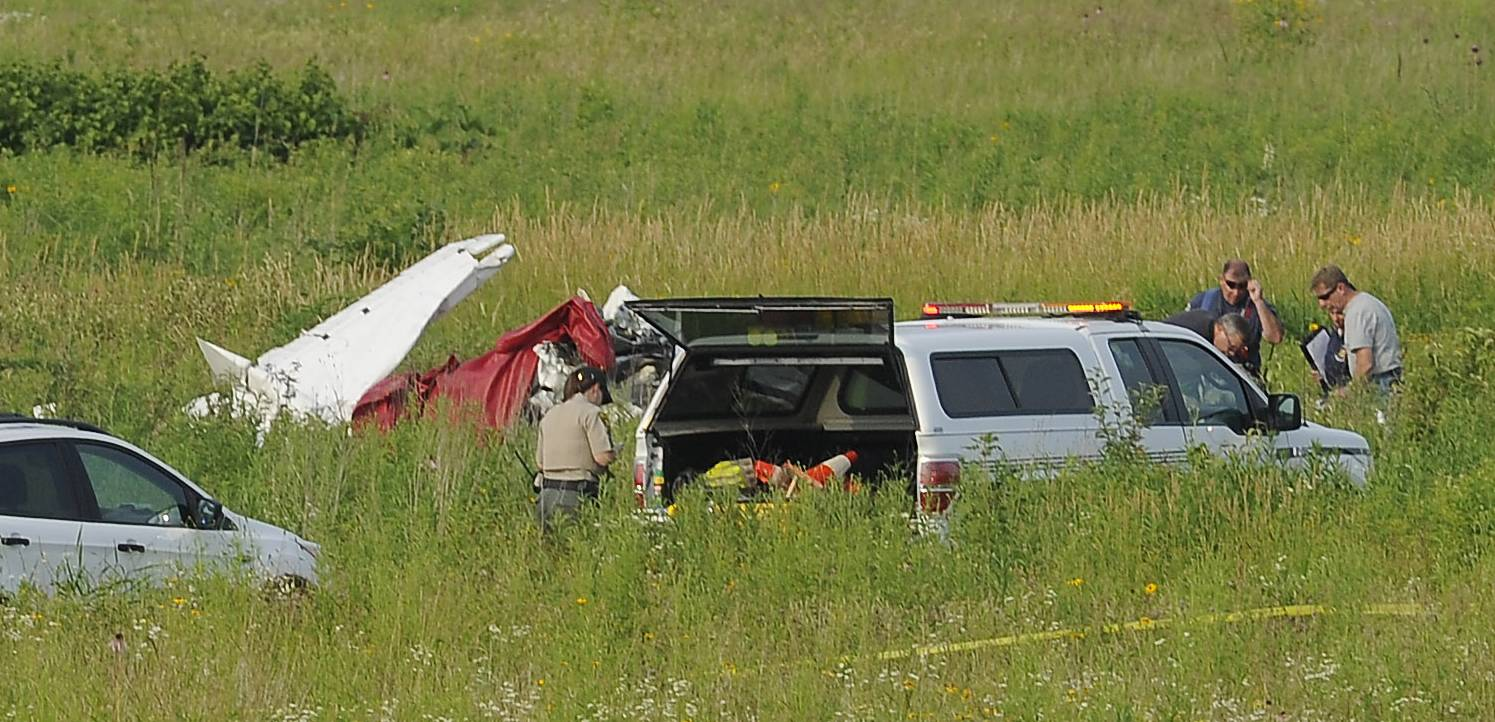 Authorities investigate a fatal plane crash in the Hawk Hollow forest preserve near Bartlett on Friday.