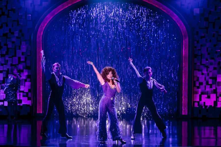 "Shoshana Bean, center, plays aspiring star Cee Cee in Drury Lane Theatre's pre-Broadway production of ""Beaches."" Josh Kohane, left, and William Carlos Angulo play her backup dancers in a mid-1970s Las Vegas-style revue."