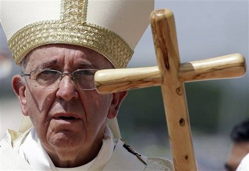 The Latest: Pope's rustic staff is replica of previous 1