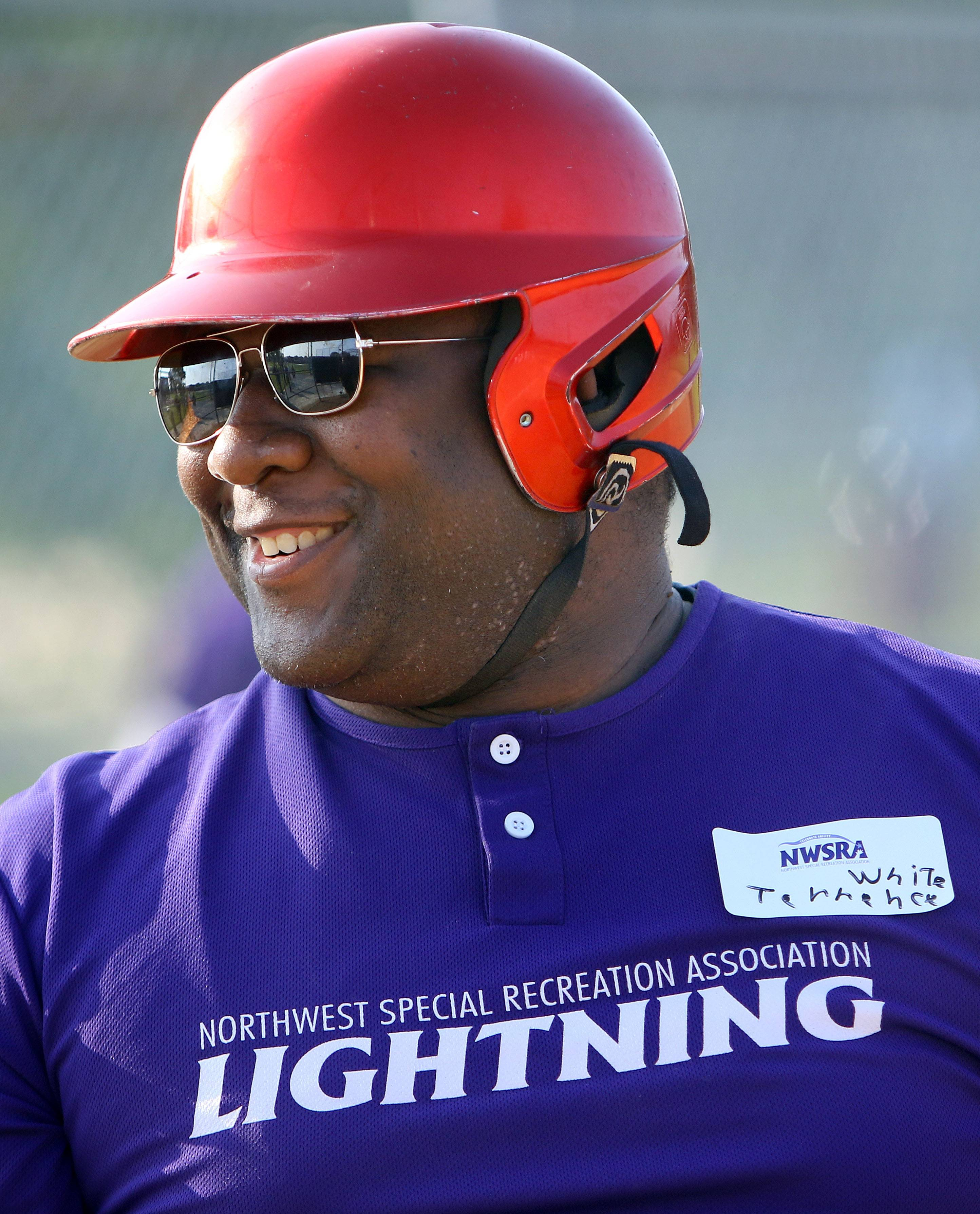 Terrence White is all smiles as 25 athletes from Northwest Special Recreation Association were paired up with high school players from the American Legion Mount Prospect Bulldogs Post 525 baseball team Tuesday during the 2015 Summer Classic at Friendship Park Conservatory in Des Plaines.